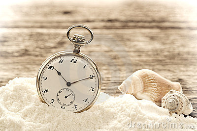 Antique Pocket Watch in Sand on Aged Wood Boards