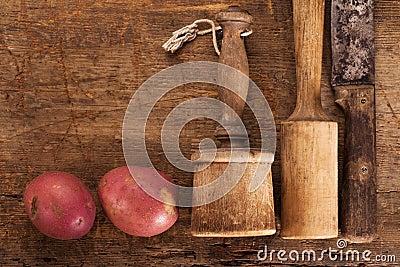 Antique potato mashers and knife
