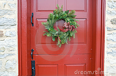 Antique red door with wreath