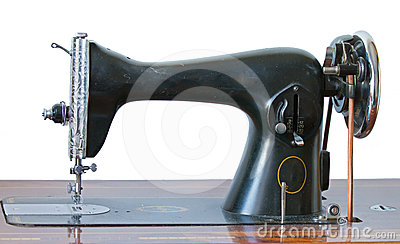 Antique sewing machine on white