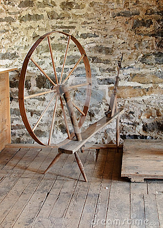 Antique spinning wheel in stone mill