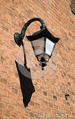 Antique style black iron wall lantern