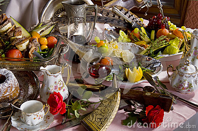 Antique tableware and food on table
