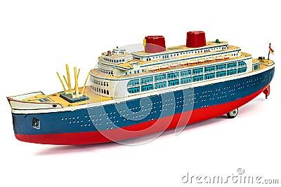 Antique toy cruise ship  on white
