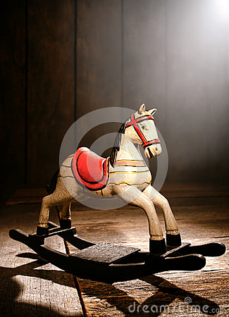 Antique Toy Rocking Horse in Old House Wood Attic