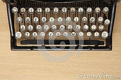 Antique typewriter on a wooden desk