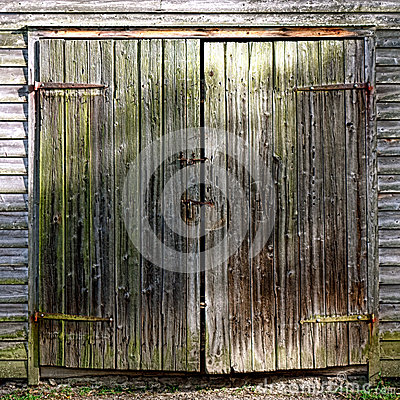 Antique Wood Barn Door On Historic Farm Building Royalty