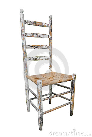 Antique wooden high-back chair isolated.