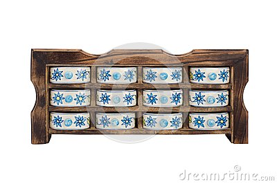 Antique wooden kitchen cupboard  with porcelain boxes for spices