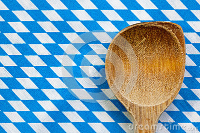 Antique wooden spoon for cooking with blue white background