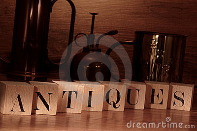 Antiques Word Spelled with Old Letter Blocks
