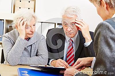 Anxious senior couple worring about