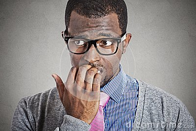Anxious young business man looking away