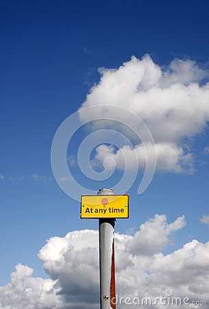 At any time sign against a blue sky