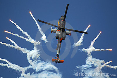 Apache helicopter shoots flares Editorial Photo