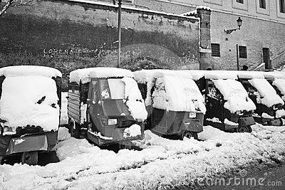 Ape Piaggio parked in the snow.