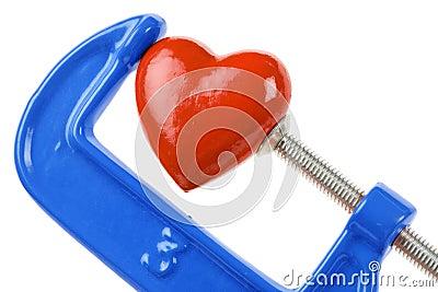 Aperto do torno e coração vermelho