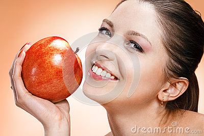 Appealing woman with apple