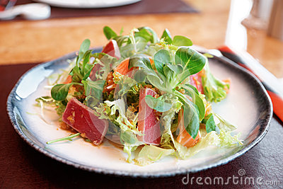 Appetizer with rare fried tuna and salmon