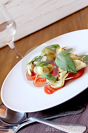 Appetizer with tomato and pumpkin slices