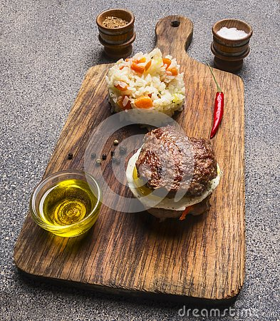 Free Appetizing Burger Only Meat And Eggs And Butter, With Rice And Vegetables,  Spices On Vintage Cutting Board Royalty Free Stock Images - 89590609
