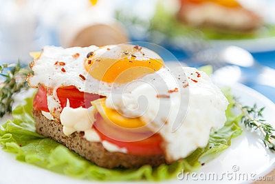 Appetizing and flavorful fried eggs with vegetables