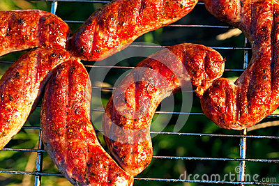 Appetizing meat sausage on the barbecue