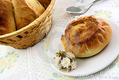 Appetizing pie and basket of pie in the tablecloth