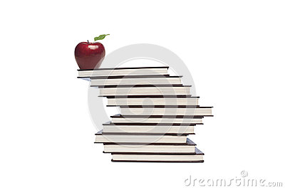 Apple and books on white
