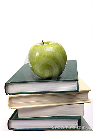 Apple and books on white vertical