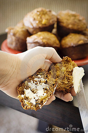 Apple Bran Muffins Being Buttered