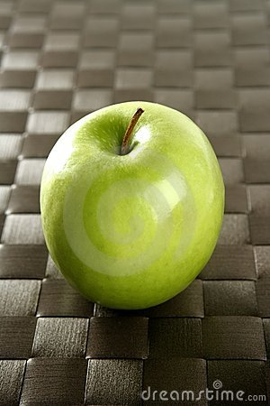 Apple on a brown tablecloth