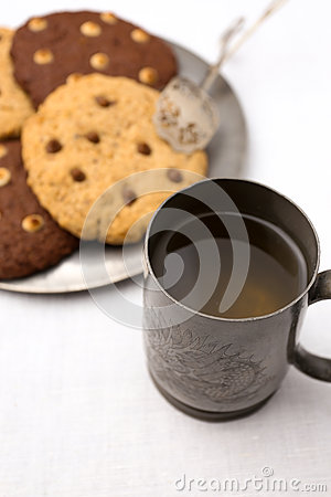 Apple Cider and Chocolate Chip Cookies On Tin Plate