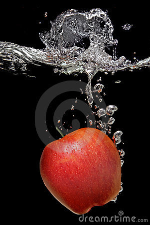Apple dropped into water with splash