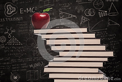 Apple education symbol and stack of books in class