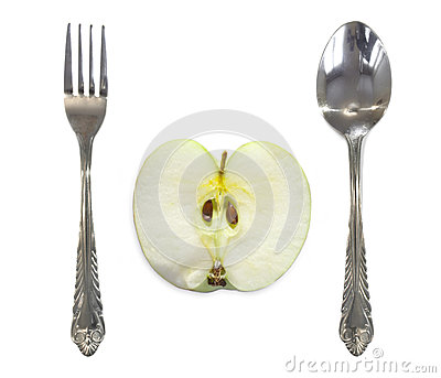 Apple between fork and spoon