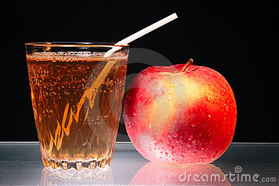 Apple and glass of juice on glass diet symbol