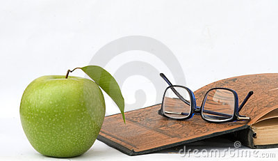 Apple, glasses and open book