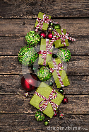 Apple green christmas presents with a red white check ribbon on Stock Photo
