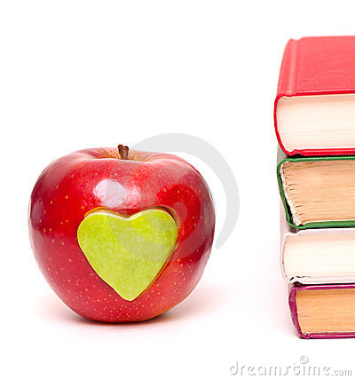 Apple with green heart and books