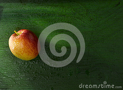 Apple on green