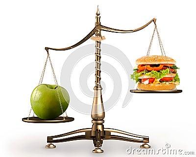 Apple and hamburger on scales conceptual hi-res