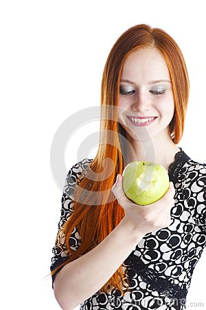 Apple in hands of the girl