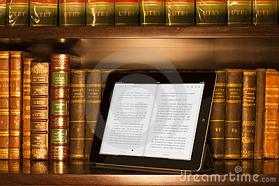 Apple ipad 2 in a  library, warm colors Editorial Stock Photo