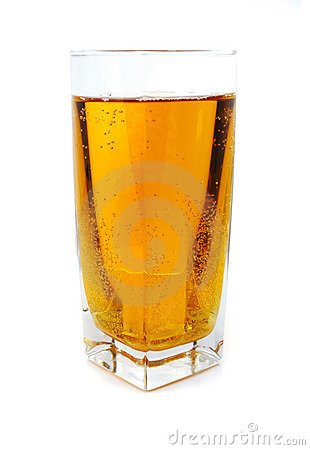 Apple juice with bubbles in glass