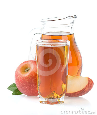 Apple juice in glass and slices on white