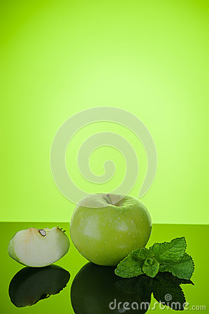 Apple with mint on green