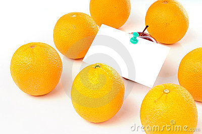 Apple with paper notes inside group of orange