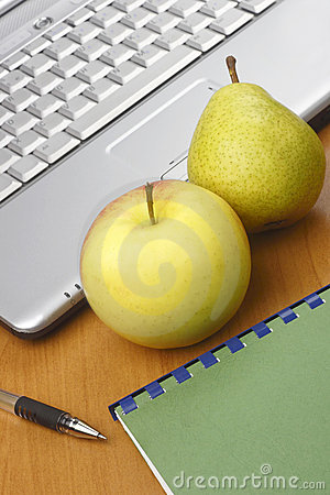 Apple,pear,pen and laptop