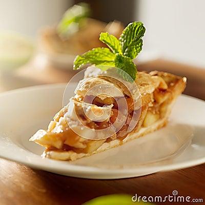 Apple pie with mint garnish.